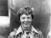 Amelia Earhart standing under nose of her Lockheed Model 10-E Electral.jpg
